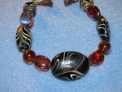 Made as a set, this bracelet utilizes a beautiful tiger eye and topaz crystals.